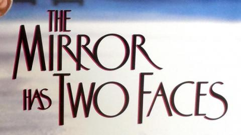 LOGO THE MIRROR HAS TWO FACES